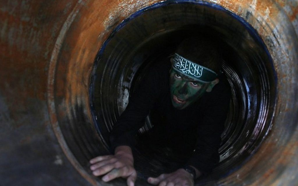 Illustrative: A Palestinian youth crawls in a tunnel during a graduation ceremony for a training camp run by the Hamas movement on January 29, 2015, in Khan Yunis, in the southern Gaza Strip. (AFP photo/Said Khatib)