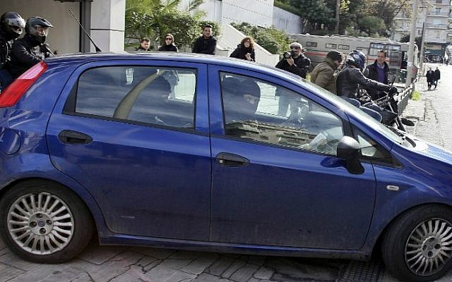 Anti-terrorist police look out from a car during the transfer of Algerian man from the Athens Appeals court on January 20, 2015 (photo credit: AFP/MAX GYSENLICK)