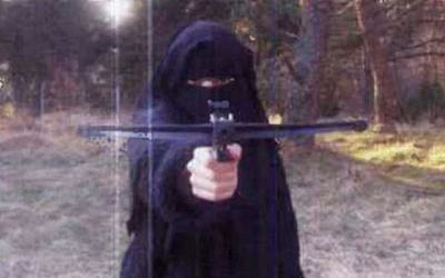 In this undated picture, Hayat Boumedienne, is seen holding what appears to be a crossbow. (Photo screenshot: Itele)