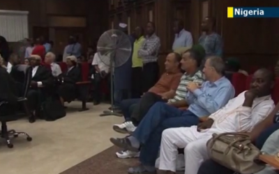 Talal Ahmad Roda and two other men accused of being Hezbollah operatives sit in a Nigerian courtroom in 2013. (screen capture: YouTube/JewishNewsOne)