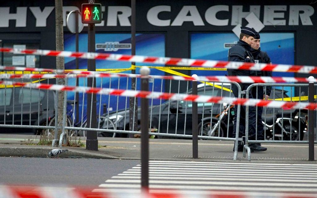Two French security officers standing guard on Saturday, January 10, 2015, the day after a terror attack on a kosher market in Paris (photo credit: AP Photo/Peter Dejong)