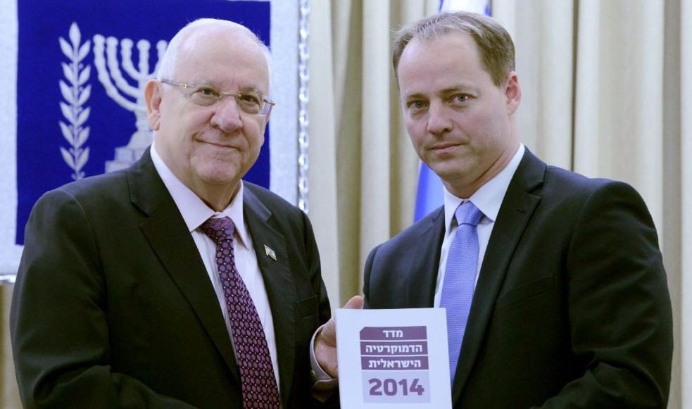 President of the Israel Democratic Institute Yohanan Plesner hands the 2015 report on democracy to President Reuven Rivlin at the president's residence in Jerusalem on January 4, 2015. (Photo credit: Mark Neyman / GPO)