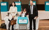 Jewish Home party leader Naftali Bennett (R) and his wife, Gilat seen cast their vote during the party's preliminary elections, in Jerusalem, on January 14, 2014 (photo credit: Yonatan Sindel/Flash90)