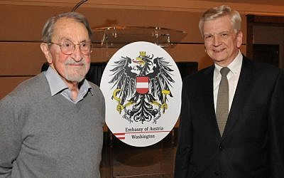 Martin Karplus, left, and Austria's U.S. ambassador, Hans Peter Manz, at the opening of an exhibition of Karplus' photographs at the Austrian Embassy in Washington, Jan. 14, 2015. (Peter Cutts/Austrian Cultural Forum/JTA)