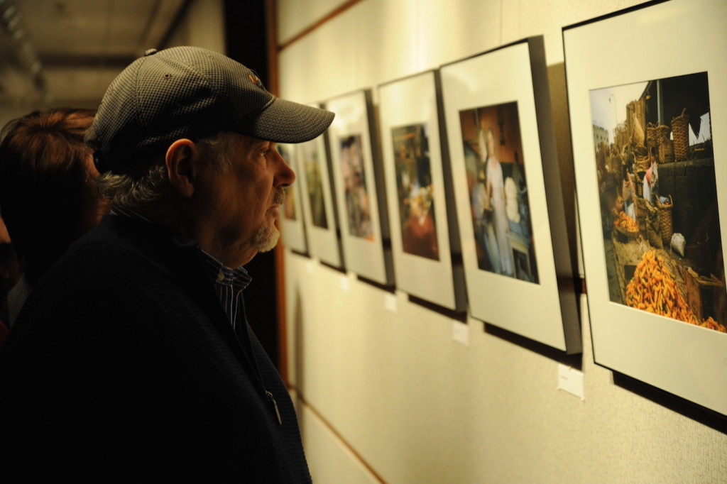 A visitor examines a photo by Nobel laureate Martin Kaplus at the opening of an exhibition of his photographs in Washington, Jan. 14, 2015. (Peter Cutts/Austrian Cultural Forum/JTA)