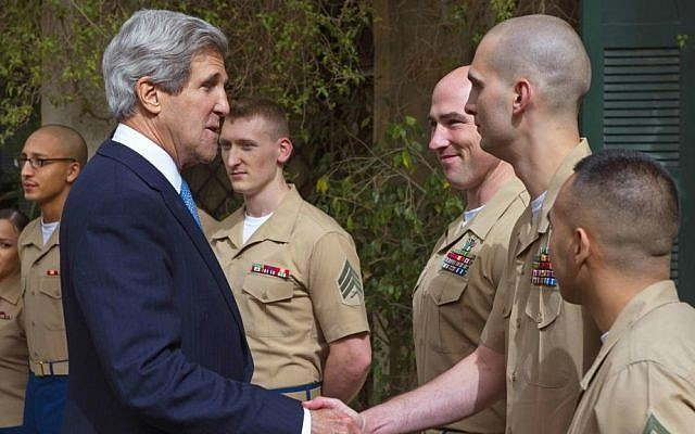US Secretary of State John Kerry with US Marines in the Jerusalem Consulate on April 8, 2013 (photo credit: AP Photo: Paul J. Richards/ Pool)