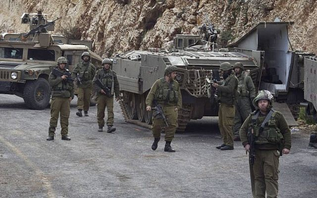 IDF soldiers secure the Israel-Lebanon border, Wednesday, Jan. 28, 2015 after Hezbollah attacked an Israeli military convoy, killing two soldiers. (Photo credit: AP/Ariel Schalit)