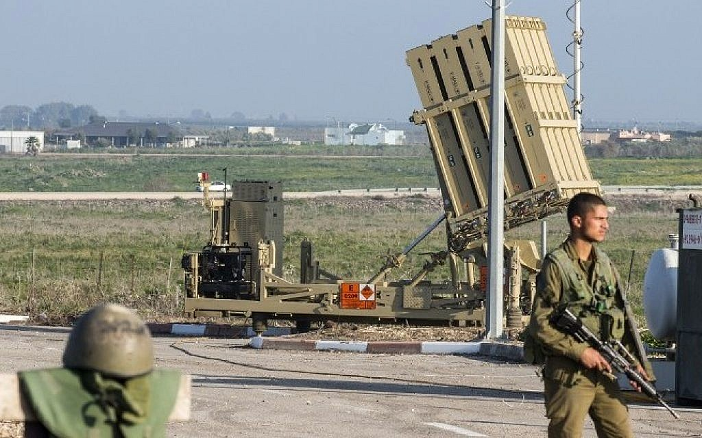 Israeli soldiers patrol near an Iron Dome defense system, designed to intercept and destroy incoming short-range rockets and artillery shells, in the Golan Heights, on January 20, 2015. (AFP/Jack Guez)