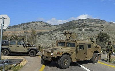 Illustrative: IDF military vehicles along the Israeli border with Lebanon, on January 28, 2015. (photo credit: Basal Awidat/Flash90)
