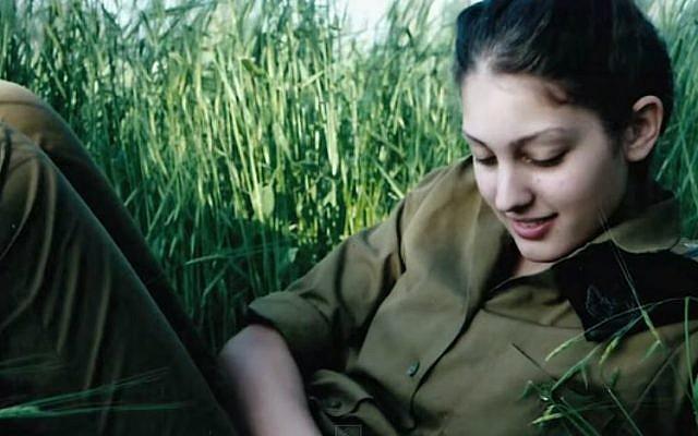 Miss Israel 2014 Doron Matalon posing in her IDF uniform. (screen capture: YouTube/Miss Universe)