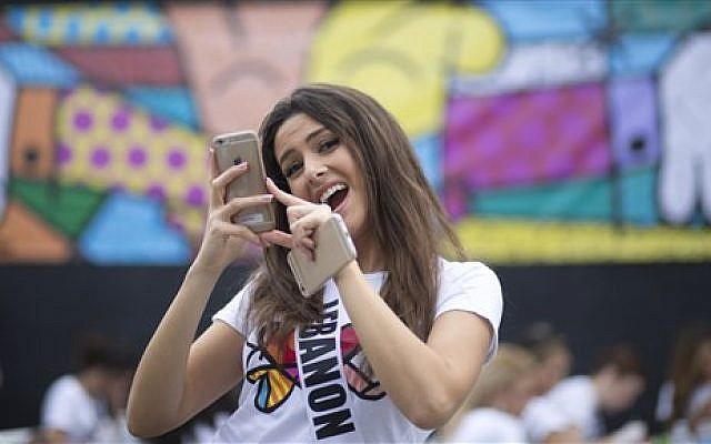 FILE - In this Sunday, Jan. 11, 2015 file photo, Miss Lebanon, Saly Greige, poses for photos after she painted on a wall in Miami's Wynwood area. (photo credit: AP Photo/J Pat Carter, File)