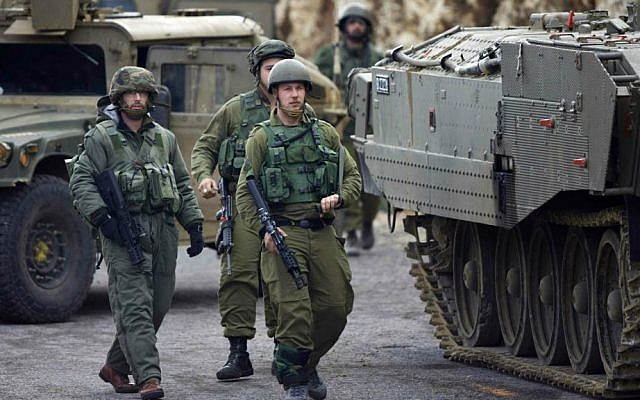Israeli army soldiers in the Mount Dov region on January 28, 2015, shortly after two soldiers were killed and seven others were wounded in a Hezbollah attack (photo credit: AP Photo/ Ariel Schalit)