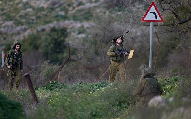 Israeli soldiers operating in the Mount Dov region on January 28, 2015, shortly after two soldiers were killed in a Hezbollah ambush (photo credit: AP Photo/ Ariel Schalit)