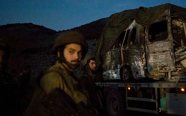 The charred remains of what appears to be a Citroen Berlingo, struck by Hezbollah forces on January 28, 2015. (photo credit: AP/Ariel Schalit)