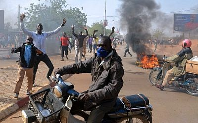 Smoke billows in a street as people demonstrate against French weekly Charlie Hebdo's publication of a cartoon of the Prophet Muhammad near the grand mosque in Niamey, Niger on January 17, 2015. (photo credit: AFP/Boureima Hama)