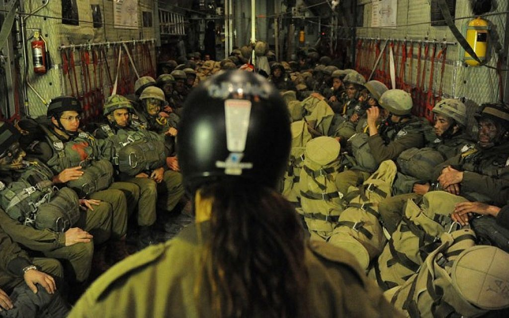 IDF Paratroopers on board a C-130 Hercules, equipped with gear pouch and ready to be linked to a static line in the plane on January 17, 2012 (photo credit: IDF Spokesperson's Unit)