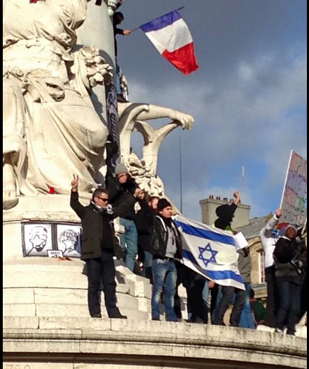 Demonstrators at Paris's Place de la Republique wave an Israeli flag during an anti-terror rally on January 11, 2015 (photo credit: John Macarthur)