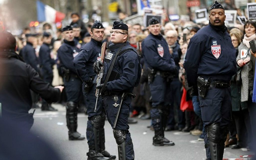 French riot police keep watch during a unity rally  in Paris on January 11, 2015 held in tribute to the 17 victims of the three-day killing spree (photo credit: AFP/ THOMAS SAMSON)