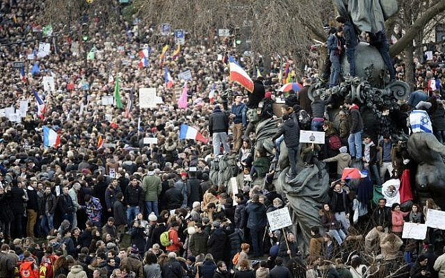 People take part in the unity rally on January 11, 2015 in Paris in tribute to the 17 victims of a three-day killing spree by homegrown Islamists (photo credit: AFP/ MARTIN BUREAU)