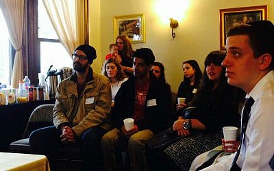 Jewish student leaders listen to a talk given by Israeli Chief Rabbi David Lau at the University of Southern California's Chabad House on January 11, 2015. (Kelly Hartog/The Times of Israel)