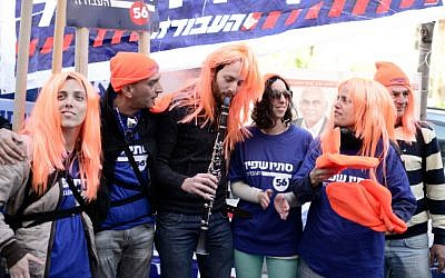 Labor supporters wear red wigs to promote Labor MK Stav Shafir during the Labor Party primaries for the upcoming general elections on January 13, 2015 (photo credit: Tomer Neuberg/Flash90)