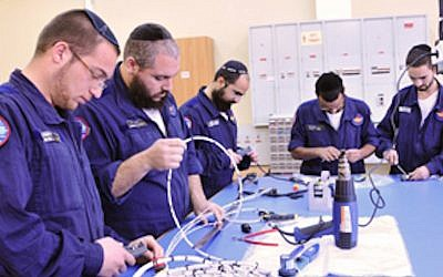 Members of the Shahar program work on a tech project (Courtesy: IAF)