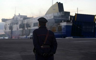 An Italian Carabiniere patrols during the checking of the Italian-owned Norman Atlantic ferry moored at the pier at the port of Brindisi on January 2, 2015 (photo credit: AFP/ Filippo Monteforte)