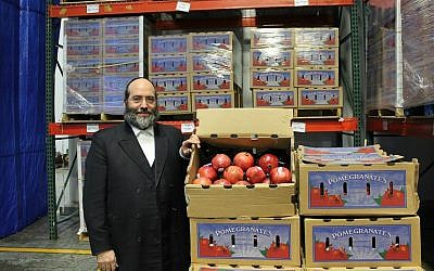 Rabbi Shulim Greenberg's organization, Chesed 24/7, receives a truckload of  pomegranates each year donated from Pom Wonderful, the nation's largest pomegranate juice producer. (Uriel Heilman/JTA)