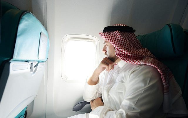 Men will still be allowed to sit with their wives. (illustrative Saudi passenger image via Shutterstock)