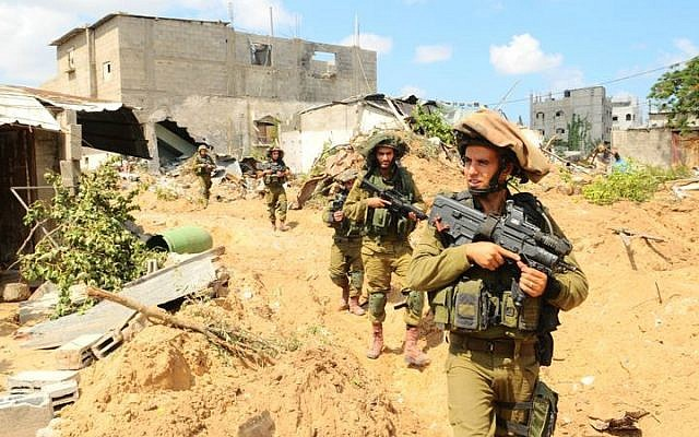 Infantry soldiers operating on the ground during Operation Protective Edge, July 20, 2014. (IDF Spokesperson's Unit/Flickr)