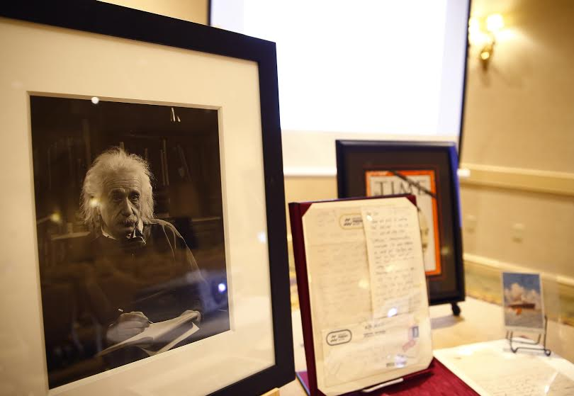During a Jan. 22, 2015 auction held in Boston, a rare postcard written by Albert Einstein from Jerusalem (far right) was auctioned for $56,250, as were other memorabilia related to the world's first celebrity scientist (photo credit: Jared Wickerham/The Times of Israel)