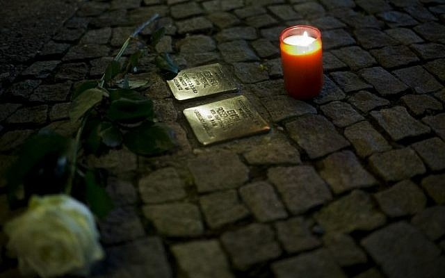Illustrative image of a 'Stolperstein,' or stumbling stone, in Berlin, November 9, 2013. (AFP/Johannes Eisele)