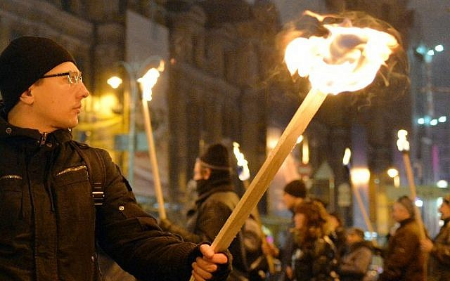 Thousands of Ukrainian nationalists hold a torchlight procession across Kiev in honor of Stepan Bandera, a World War II anti-Soviet insurgent, on January 1, 2015 (photo credit: AFP/Genya Savilov)