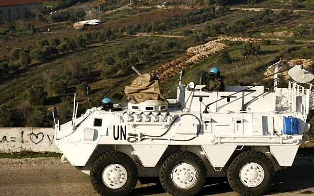 A Spanish UNIFIL peacekeeper drives an armored vehicle in the Lebanese town of Adaisseh, near the border with Israel, on January 19, 2015. (AFP/Mahmoud Zayyat)