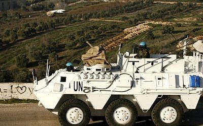 File: A Spanish UNIFIL peacekeeper drives an armored vehicle in the Lebanese town of Adaisseh, near the border with Israel, on January 19, 2015. (AFP/Mahmoud Zayyat)