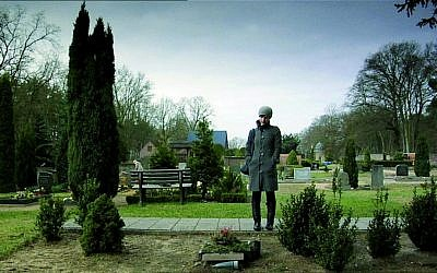 Israeli filmmaker Yael Reuveny, graveside in Europe, in the award-winning documentary 'Farewell Herr Schwarz.' (courtesy KinoLorber)