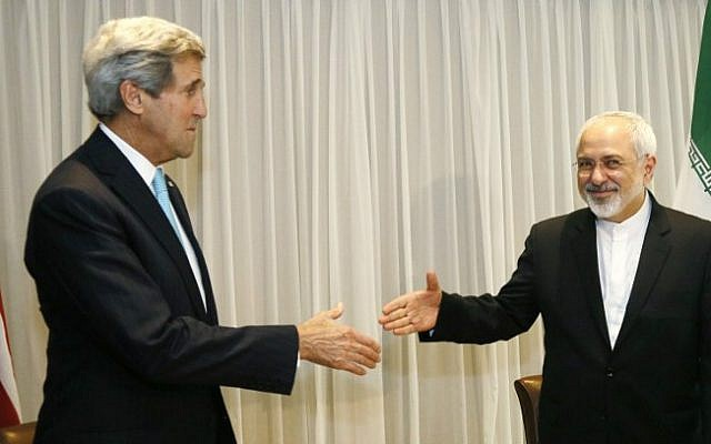 Iranian Foreign Minister Mohammad Javad Zarif shakes hands with US State Secretary John Kerry in Geneva, Jan. 2015 (photo credit: AFP / POOL / RICK WILKING)