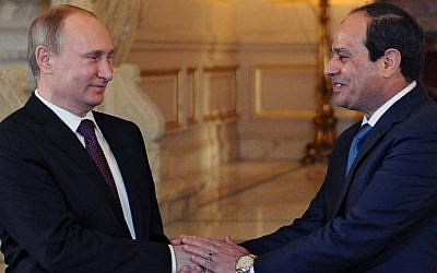 Egyptian President Abdel-Fattah el-Sissi (right) shakes hands with his Russian counterpart Vladimir Putin during their meeting in Cairo on February 10, 2015. (photo credit: AFP/ Ria Novosti/Mikhail Klimentyev)
