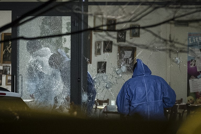Forensic police officers work at a cultural center in Copenhagen, Denmark, where shots were fired during a debate on Islam and free speech on February 14, 2015. (photo credit: AFP PHOTO / CLAUS BJORN LARSEN)