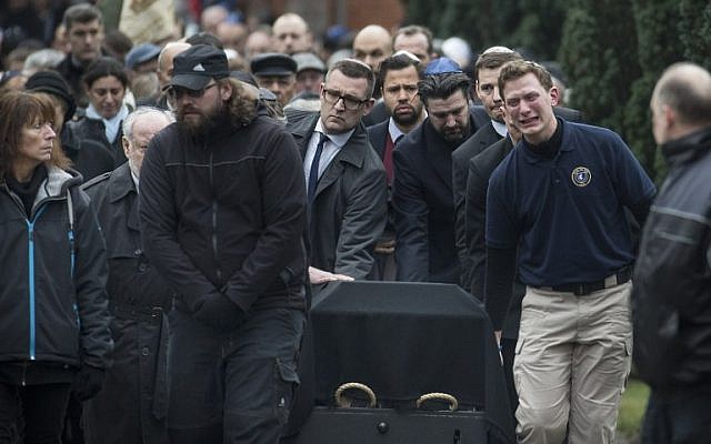 Mourners carry the coffin of Dan Uzan, Jewish victim of the February 15, 2015 attacks, during his burial at a Jewish cemetery in Copenhagen on February 18, 2015. (photo credit: AFP PHOTO / CLAUS BJOERN LARSEN)