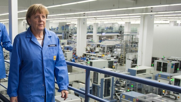 German Chancellor Angela Merkel visits a Siemens Industrial electronics factory in Amberg, southern Germany on February 23, 2015. (photo credit: Armin Weigel/DPA/AFP)