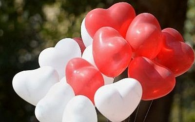 Valentine's Day is observed on February 14 each year (Photo credit: Farroq Naeem/AFP)