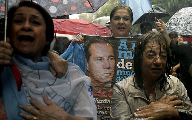 People take part under heavy rain in the March of Silence called by Argentine prosecutors in memory of their late colleague Alberto Nisman in Buenos Aires on February 18, 2015. (photo credit: AFP/Juan Mabromata)