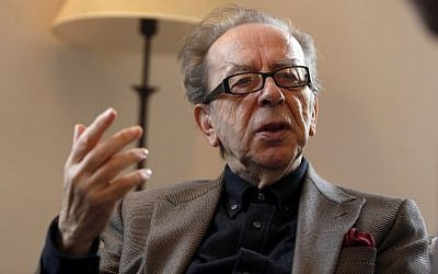 Albanian novelist Ismail Kadare gestures during an interview with AFP on February 8, 2015 in Jerusalem. (photo credit: AFP/ Gali Tibbon)