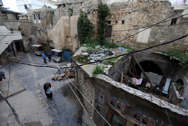 A woman walks in an alleyway leading to the fading synagogue that was built in 1885 in Sidon, Lebanon on Feb. 8, 2015.
