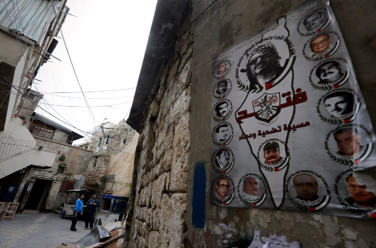 A poster of the Palestinian Fatah movement plastered on one of the walls of a fading synagogue in Sidon, Lebanon on February 8, 2015. Nothing remains that gives a sense of the vibrant Jewish community that once lived in Sidon. (Photo credit: Joseph Eid/AFP)