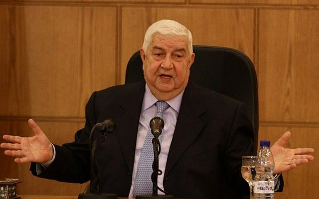 Syrian Deputy Prime Minister and Foreign Minister Walid Moallem speaks during a news conference with Minister of Foreign Affairs of Belarus Vladimir Makei in Damascus on February 9, 2015. (photo credit: AFP/LOUAI BESHARA)