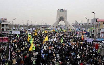 Iranians gather in Tehran's Azadi Square (Freedom Square) for a rally to mark the 36th anniversary of the Islamic revolution, February 11, 2015. (photo credit: AFP PHOTO / ATTA KENARE)
