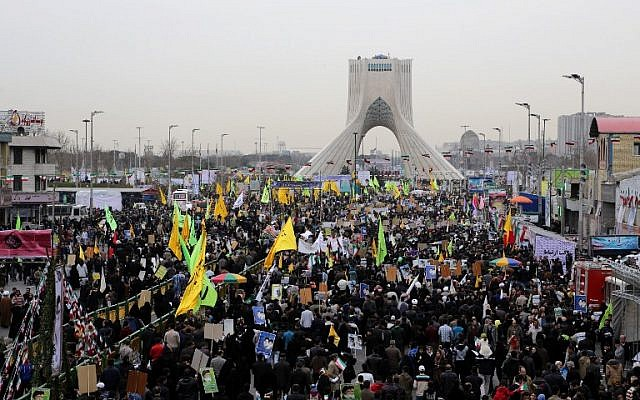 Iranians gather in Tehran's Azadi Square (Freedom Square) for a rally to mark the 36th anniversary of the Islamic revolution on February 11, 2015. (photo credit: AFP PHOTO / ATTA KENARE)
