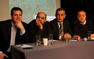 Joint Arab List members (from left to right), Ayman Odeh, Masud Ghanayem, Jamal Zahalka and Ahmad Tibi sit together during a press conference in Tel Aviv on February 11, 2015. (photo credit: AFP/GIL COHEN-MAGEN)